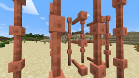 A Minecraft screenshot of several Lightning Rods organised in a shamefully impractical manner in the middle of a desert.