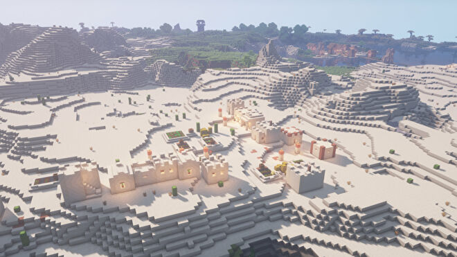 A desert village in Minecraft, viewed from an aerial perspective with shaders enabled.