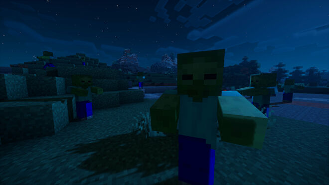 A nighttime Minecraft screenshot of a zombie looking at the player, with several more zombies wandering around in the background.