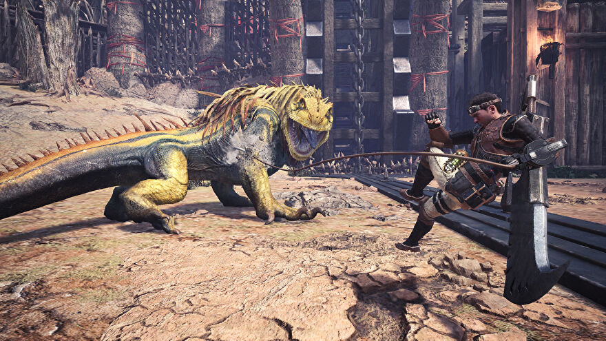 An image from Monster Hunter: World which shows the player grappling hook towards a huge Jagras (a yellow lizard).