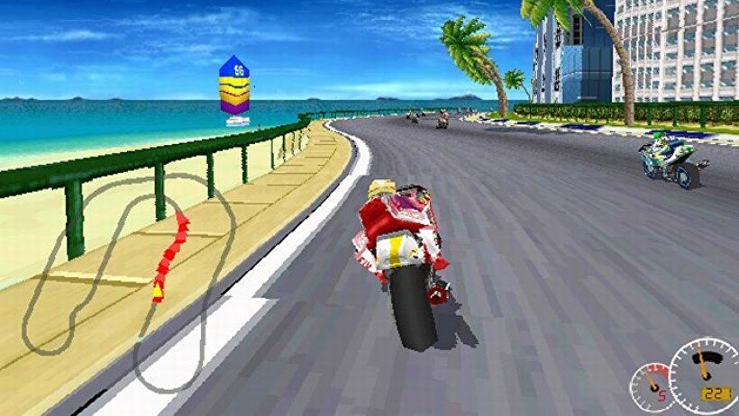 An image from Moto Racer which shows the player racing a motorcycle along a coastal road, with the sea on the left, and palm trees to the right.