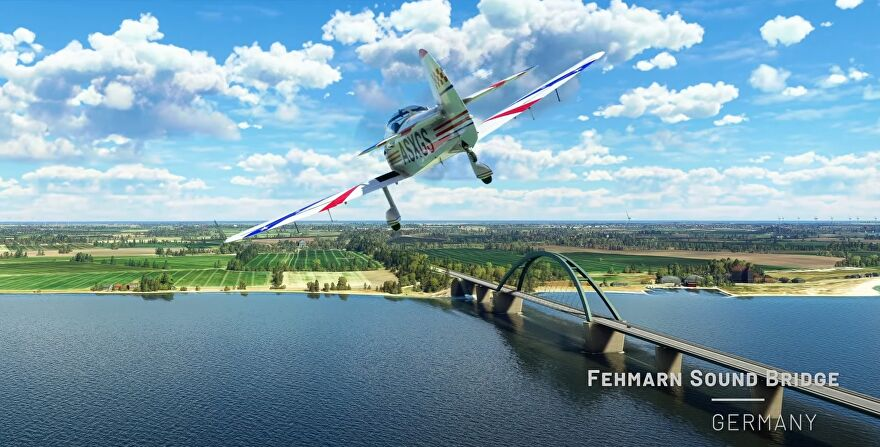 A screenshot showing a plane in Microsoft Flight Simulator flying past the Fehmarn Sound Bridge in Germany.