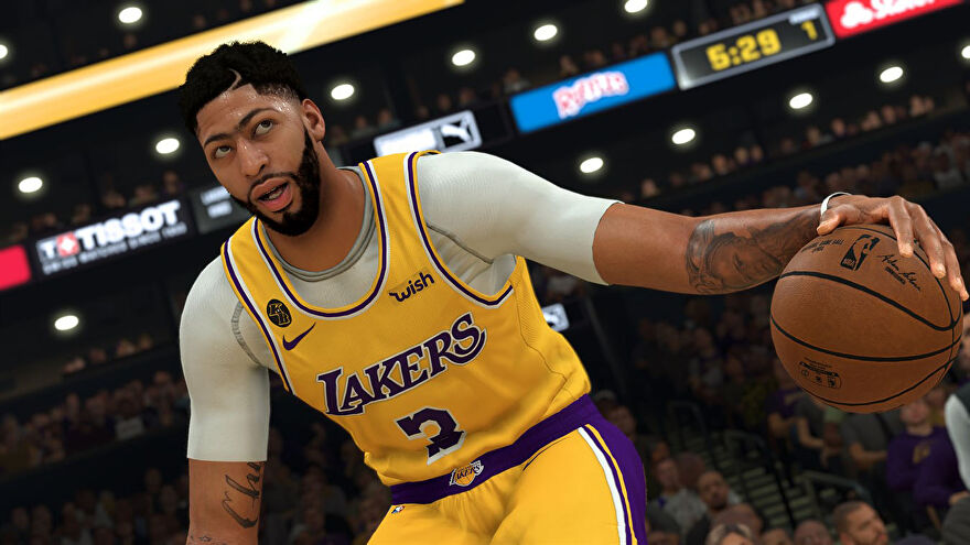 A basketball player in NBA 2K21 looking up at a crowd. He is ready to shoot a hoop.