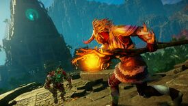 A New World character carrying a Fire Staff faces off against a supernatural enemy, against the backdrop of an eerily glowing tower fortress.