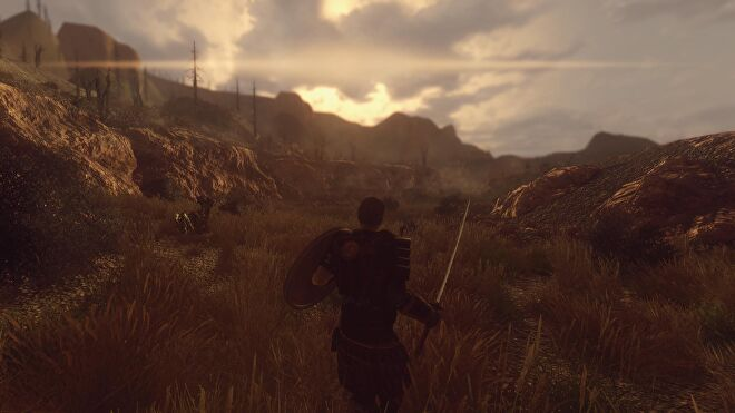 A man holds a sword and shield in a grassy plain the New California mod for Fallout: New Vegas