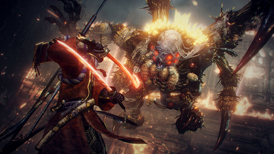 Fighting an awful spider demon in a Nioh 2 screenshot.