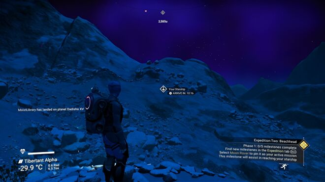 No Man's Sky - The player stands on a snowy, dark and barren planet looking at a waypoint showing their ship's location which is a ten-minute walk on foot. The temperature is reported at -29.9 Celcius.