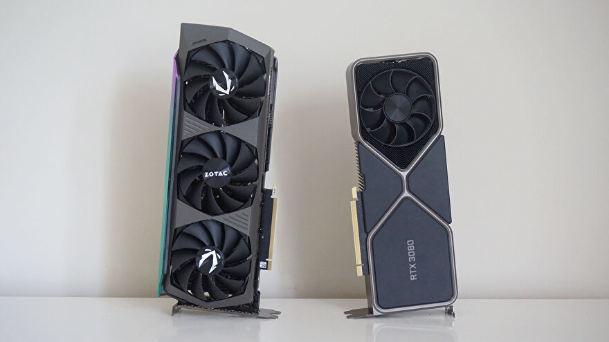 The Nvidia RTX 3080 and RTX 3080 Ti graphics cards side by side on a table