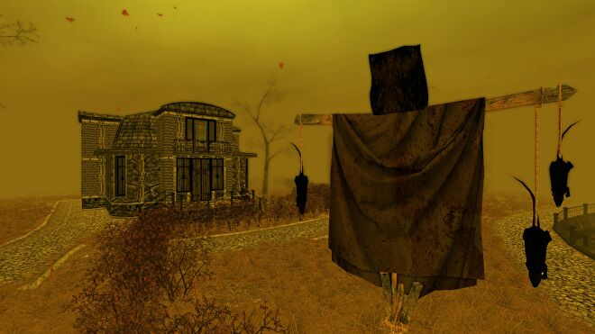 A screenshot from Pathologic showing a yellow landscape - yellow sky, yellow grass - with a squat stone home in the background and a makeshift scarecrow in the foreground, dead rats hanging from its arms