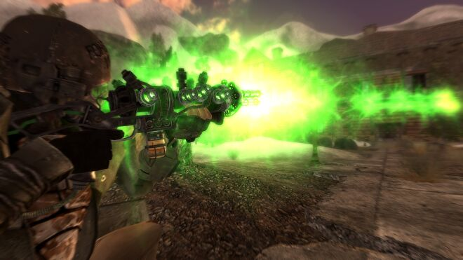 A man fires a green energy ray out of a gun in the Project Nevada mod in Fallout: New Vegas