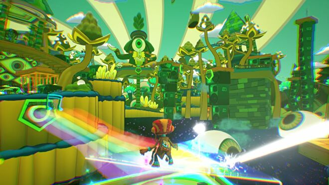 A level landscape in Psychonauts 2, a world of green and yellow towers made of strange plants and stacks of amps. In the distance is a giant statue of a person whose entire head is a giant eye. They're holding a green violin