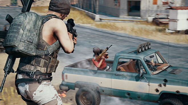 A player takes aim at a truck in PUBG.
