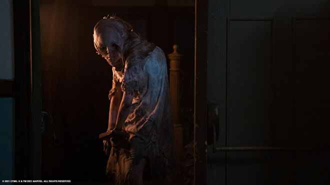 A screenshot of Marina Mazepa as Lisa Trevor, a tortured and mutated monster-girl, in Resident Evil: Welcome To Raccoon City