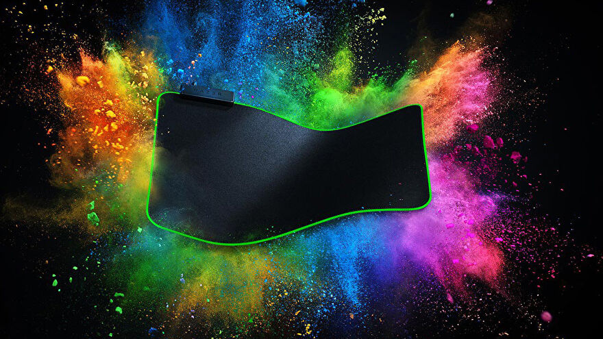 a photo of a razer goliathus desk-sized mouse pad, with colour exploding behind it
