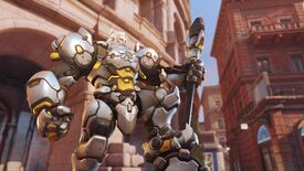 Overwatch 2's Reinhardt standing proud with a leg on his hammer.