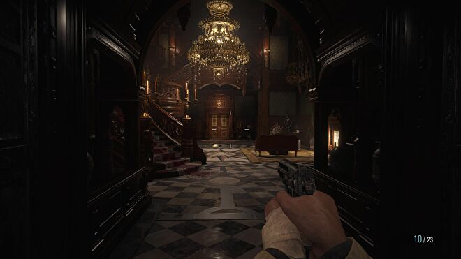 I enter Dimitrescu's castle and stare out into the lobby, which is lit by a chandelier.