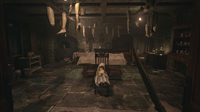 A workshop with lots of wooden puppet parts in House Beneviento in Resident Evil Village