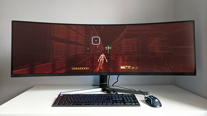 A photo of an ultrawide gaming monitor running Rez Infinite