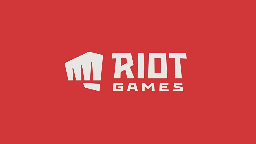 """An image of the Riot Games logo, showing white text which reads """"Riot Games"""" next to a clenched white fist against a red background."""