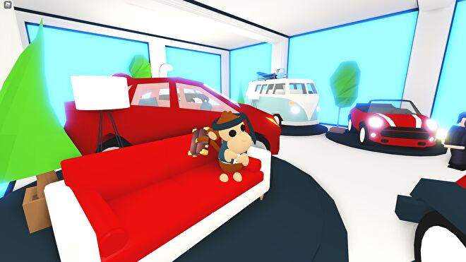 A pet monkey sitting in a car show room in Adopt Me!