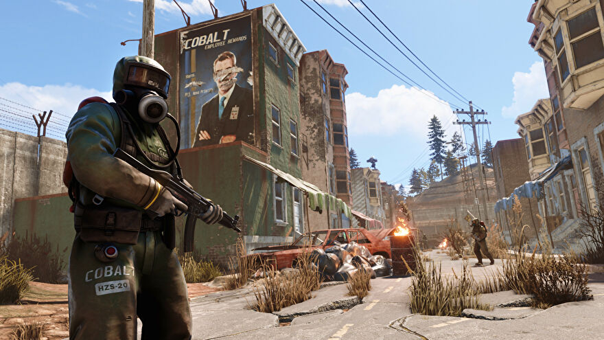 Armed people in hazmat suits stand in a ruined street in a Rust screenshot.