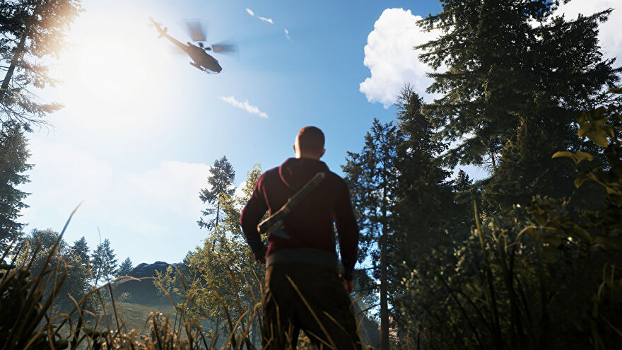 A person in a forest with an axe stares up at a helicopter in a Rust screenshot.