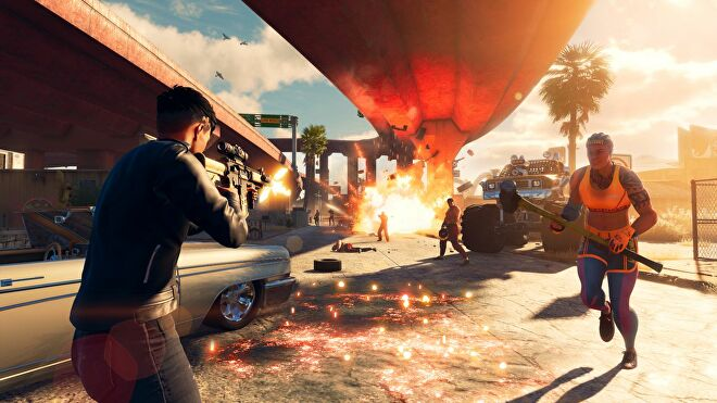 A combat scene in the new Saints Row reboot, taking place under a freeway bridge. There is an explosion in the background as the player character shoots at rival gang members