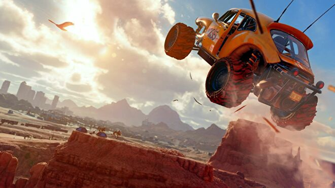 A buggy jumping over an arid desert landscape in the new Saints Row Reboot