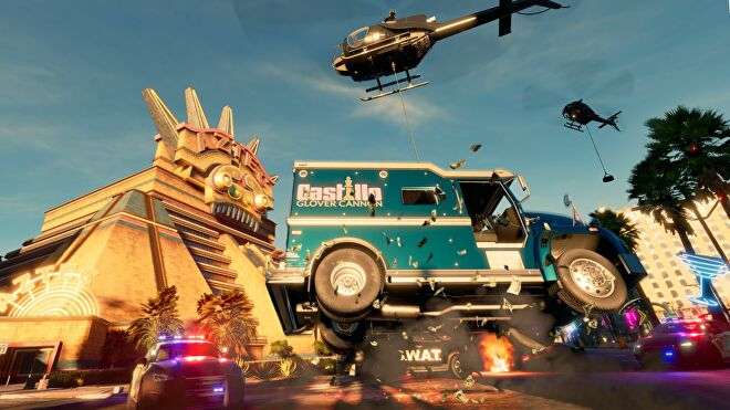 A screenshot from the new Saints Row reboot showing a blue armoured car being stolen by being airlifted by a helicopter