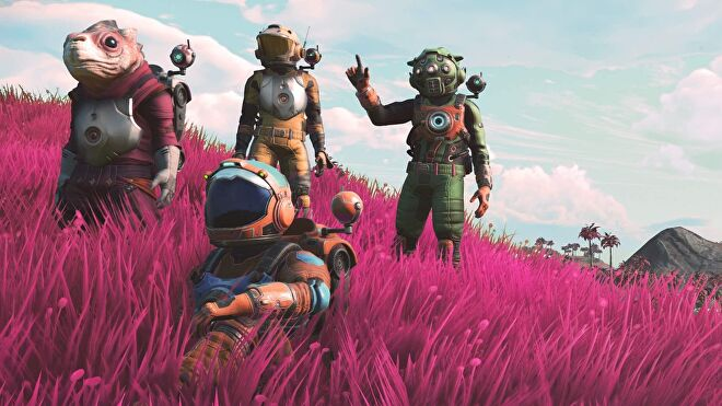 No Man's Sky - Four space suit-wearing characters stand and sit together in tall, pink grass looking up into the sky.