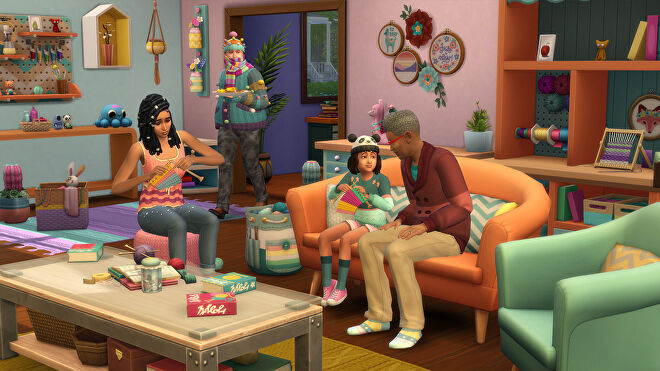 A group of Sims sitting in a living room knitting. One Sim is swathed in knitwear to the point of struggling to move.