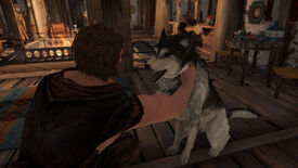 Skyrim - A player character is kneeling and petting a husky.