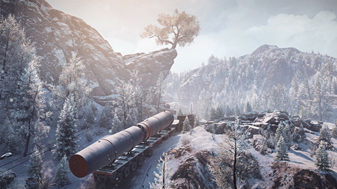 Hauling a space rocket through the snow in a screenshot from SnowRunner's Season 4 DLC missions.