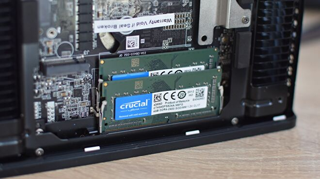 Two sticks of SO-DIMM RAM installed inside a mini-PC.