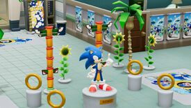 A screenshot of a hospital filled with rings, a Sonic statue, and Sonic posters in Two Point Hospital.
