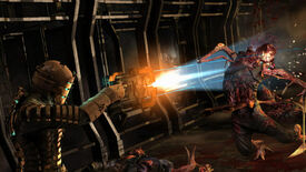A man in a metal space suit attacks a monster with a laser cutter in Dead Space