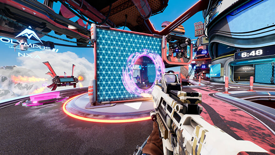 A Splitgate player creates a portal on a wall in front of them.