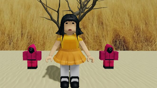 The Red Light Green Light game from Squid Game set up in Roblox. The focus of the picture is on a giant doll and two guards.