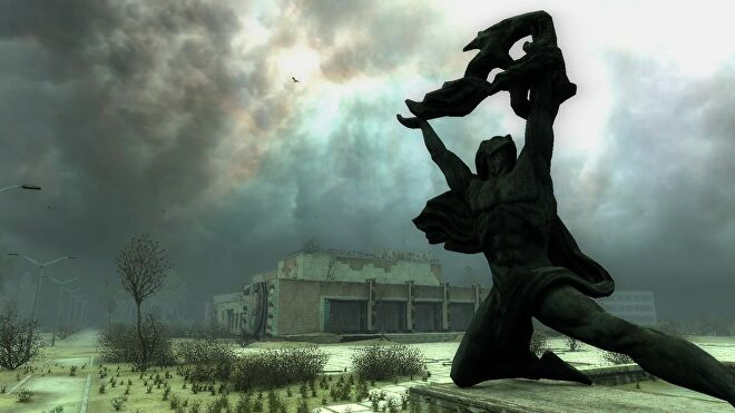The landscape of STALKER, a statue of a man holding up a flaming torch in the foreground, a crumbling building in the background, and strange blue light in the cloudy skies
