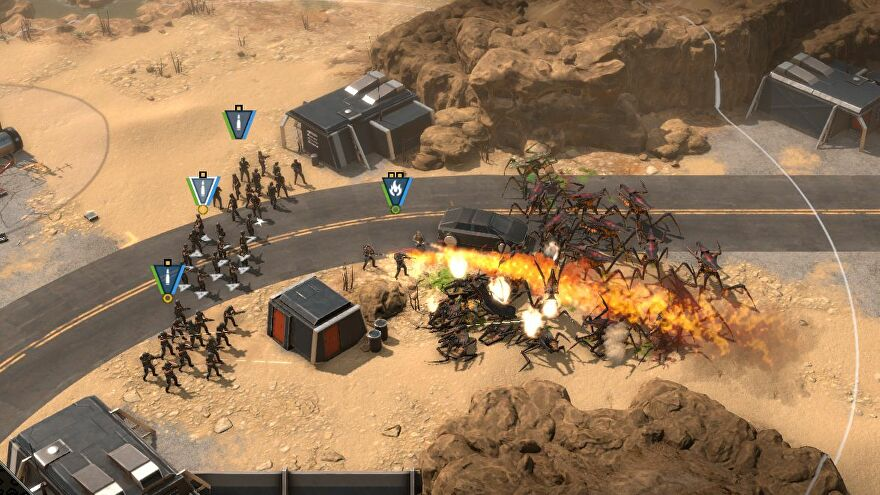 3 squads of human rifles (plus a team of combat engineers with flamethrowers) attack a horde of oncoming bug aliens in the demo for Starship Troopers - Terrann Command