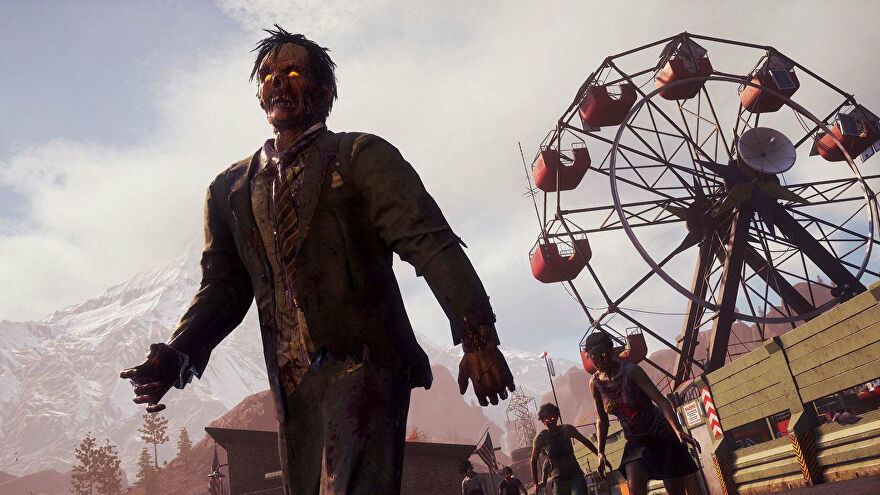 Zombies by a ferris wheel in State of Decay 2's new version of the Trumbull Valley map.
