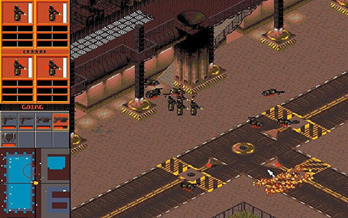 A screenshot of the original Syndicate, showing an isometric view of a city street covered in bodies and fire.