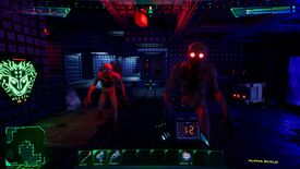 A screenshot of the System Shock remake, showing a metal corridor bathed in red light and in the foreground two zombie-like enemies rushing toward the player.