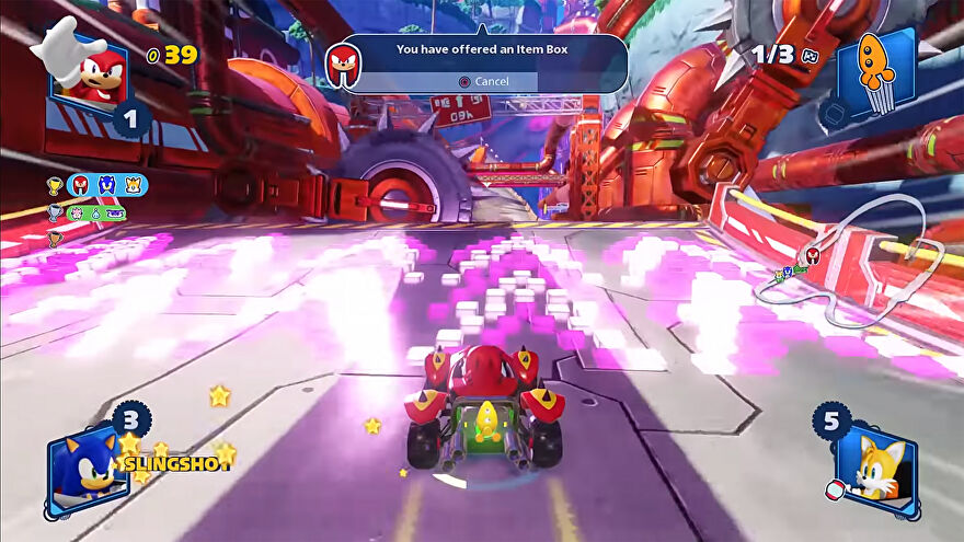 A screenshot of Team Sonic Racing gameplay that shows Knuckles being offered an item box transfer right before he hits a speed boost ramp