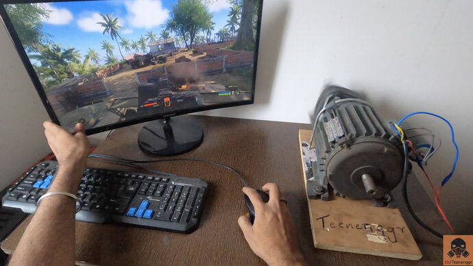 A photo showing a monitor and keyboard on a desk alongside a motor that is about to rumble like crazy.