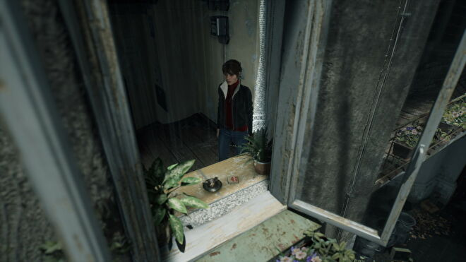 A screenshot of Marianne looking out a window in The Medium with ray tracing switched on