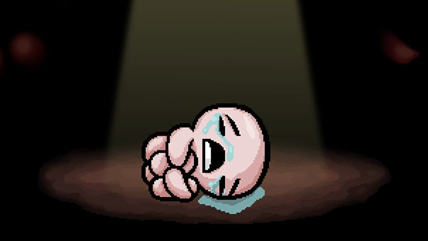 Isaac curled up crying on the floor in The Binding Of Isaac: Rebirth's loading screen.