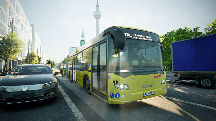 A screenshot of The Bus, a bus simulator, featuring a yellow Scania bus in the foreground, idling in traffic, with buildings and trees from a Berlin street in the background.