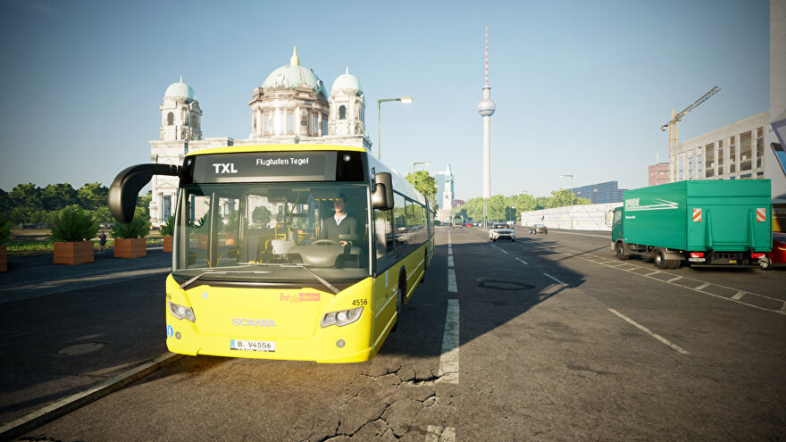 Driving a yellow Scania bus through Berlin in a screenshot of The Bus.