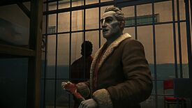 The Long Dark - Mathis stands inside a prison cell holding a wrench and talking with the player while another convict stands guard outside.